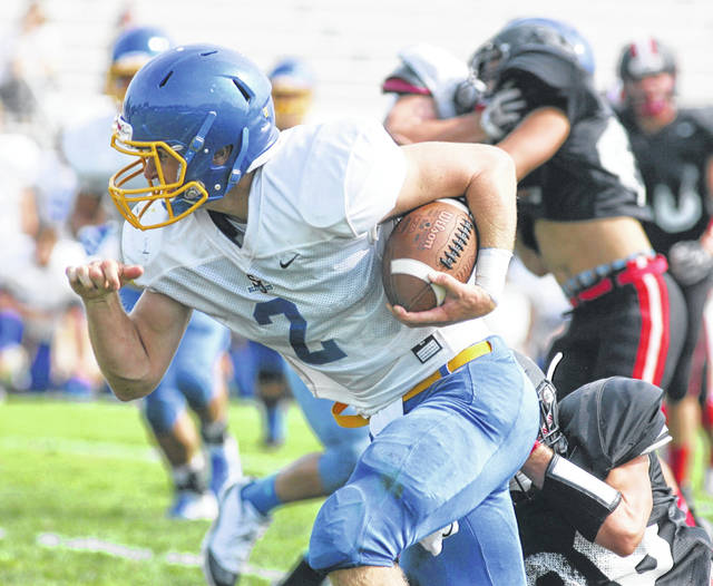 Delphos St. John's quarterback Jared Wurst heads up field after being forced out the pocket during a Tuesday morning scrimmage at Stadium Park.