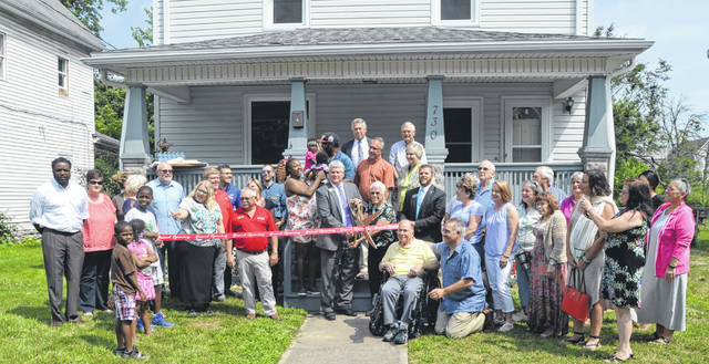 Lvera Sprague, donator of the home on 730 W. Elm St., and Jed Metzger President of the Chamber of Commerce cut ribbon for the opening of the new Sprague Transitional House Tuesday.