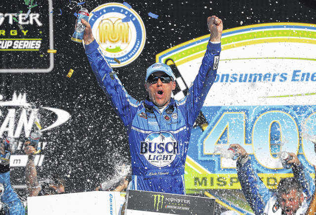 Kevin Harvick celebrates his victory after a NASCAR Cup Series auto race at Michigan International Speedway in Brooklyn, Mich., on Sunday.It was his seventh win this year.