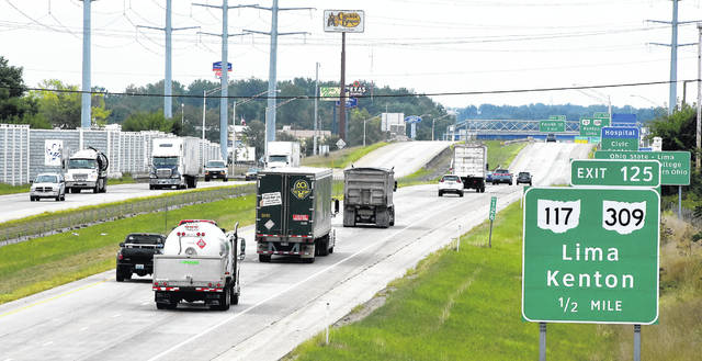 Traffic travels north and south on Interstate 75 on Thursday. There will be 8.2 percent more Ohioans departing for the Labor Day holiday between Thursday and Monday, according to AAA.