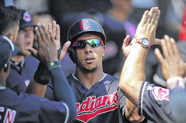 Cleveland Indians outfielder Michael Brantley celebrates with teammates after scoring a run against the Chicago White Sox during the second inning of Sunday's game.