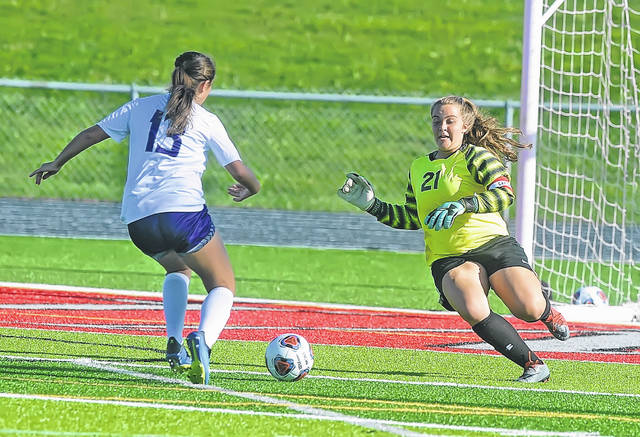 Lima Senior's Morgan Twining gets a block on the goal attempt of Fremont Ross Mackenzie Kidwell during Wednesday's match at Spartan Stadium. No score was reported.
