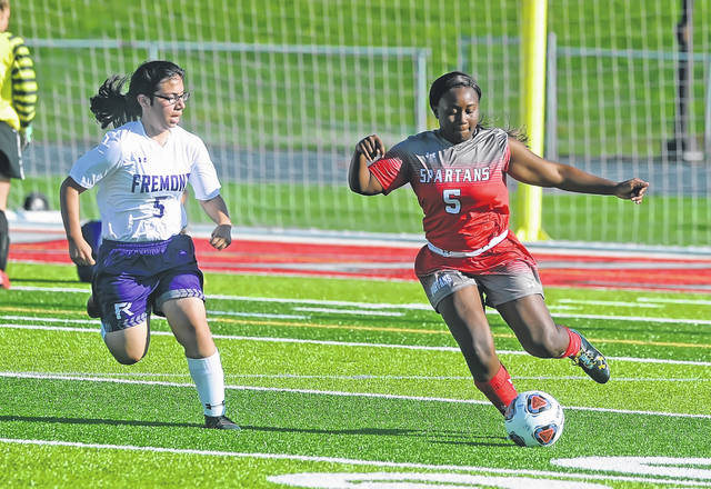 Lima Senior's Zia'Kaijiah Ware dribbles ahead of Fremont Ross Mia Ramirez during Wednesday's match at Spartan Stadium. No score was reported.