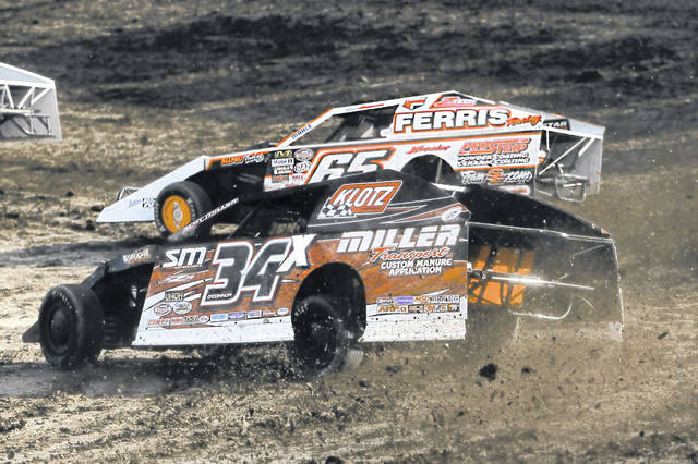 Shane O'Connor (34) races with Todd Sherman in turn three at Limaland last Friday night.