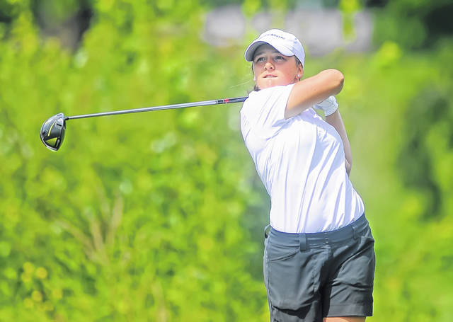 Lima Central Catholic's Erin Mulcahy watches her tee shot during Wednesday's Allen County Girls Golf Championship at Lost Creek Golfers Club. See more tournament photos at LimaScores.com.