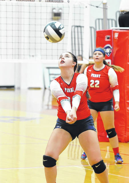 Perry's Annabell Plaugher sets the ball during Tuesday night's match against Delphos Jefferson at Leonard V. Tolbert Gymnasium.