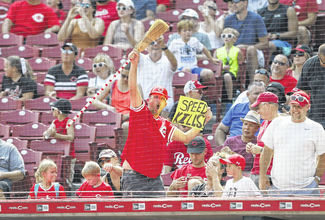 A fan cheers the Cincinnati Reds during the eighth inning of their 11-4 win over the San Francisco Giants on Sunday to complete a three-game sweep of a series with the Giants.
