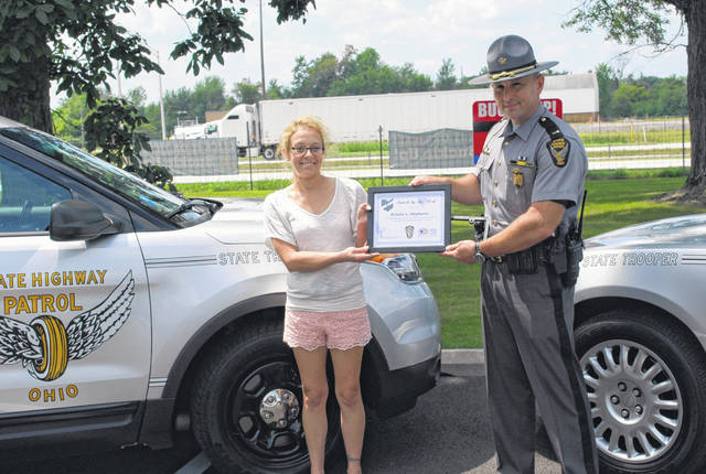 "Kristie Hayhurst, of Delphos, was presented Thursday with the Ohio State Highway Patrol's ""Saved by the Belt"" award. Hayhurst, 38, walked away with relatively minor injuries following a single-car crash in July of this year near Spencerville. Patrol officials credited her use of seat belts with saving her life as well as that of her young niece, who was an occupant of the vehicle."