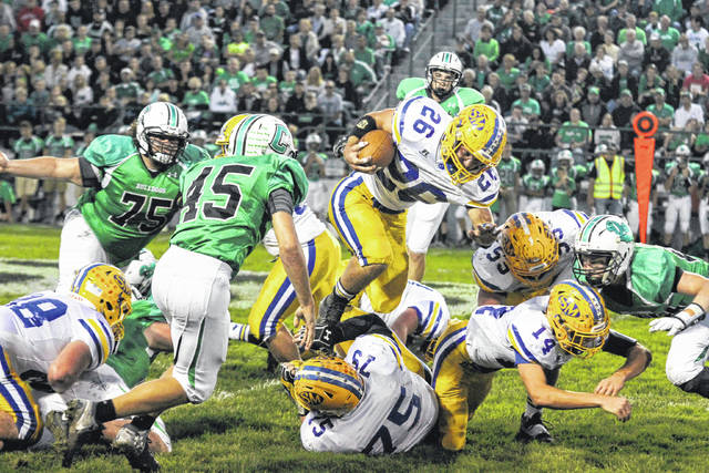 St. Mary's Ty Schlosser was part of the Roughrider backfield that helped capture the Western Buckeye League title. He, along with the rest of his teammates, will try for a third straaight title this season.
