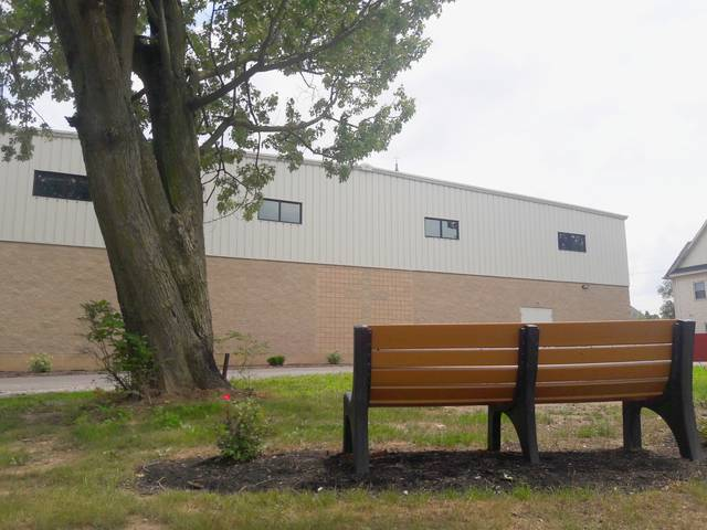 A bench sits on a property donated by the Allen County Land Bank to St. Rose School. The property had formerly been the site of a tax-delinquent, dilapidated property.