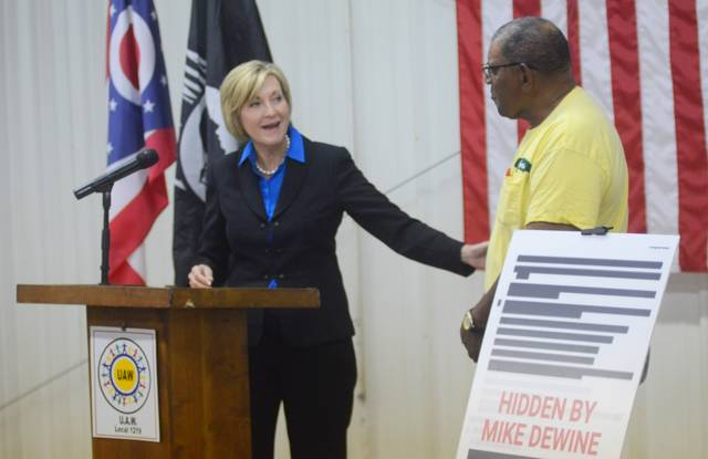 Democratic lieutenant governor candidate Betty Sutton talks to veteran Courtney Gaiter during a press conference Thursday. Sutton called on Republican gubernatorial candidate Mike DeWine to clear redactions on emails from the Ohio Attorney General's office giving details about an incident involving BCI agents using expired Kevlar vests.