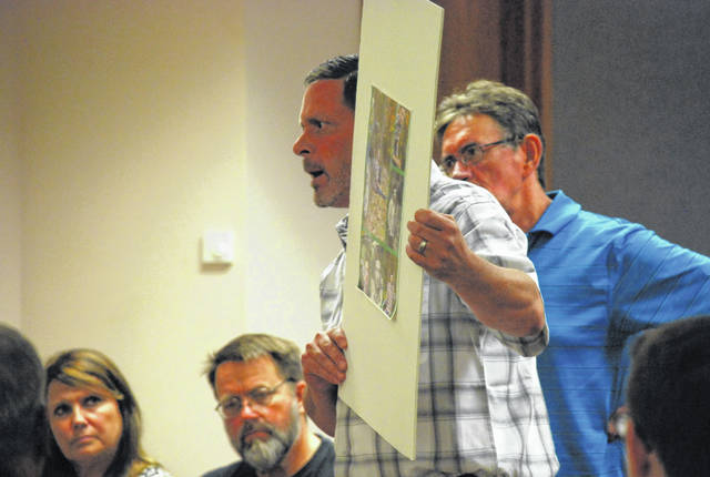 The father of Brenden Wale held a poster with pictures of his late son during Tuesday's sentencing hearing for Zachery Brown, a 23-year-old Michigan man who was driving drunk at the time of a traffic accident that caused Brenden Wale's death.