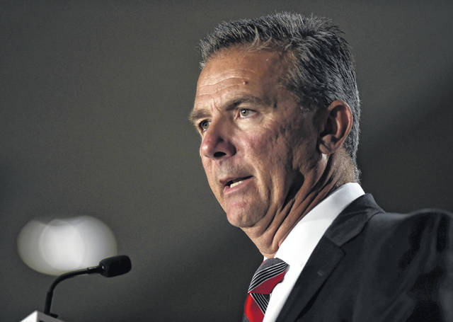 File-This July 24, 2018, file photo shows Ohio State head coach Urban Meyer speaking at the Big Ten Conference NCAA college football Media Days in Chicago. The Big Ten East has been called the toughest division in college football, and that's expected to be the case again this season even with the uncertainty surrounding Meyer and his defending conference champion Ohio State Buckeyes.