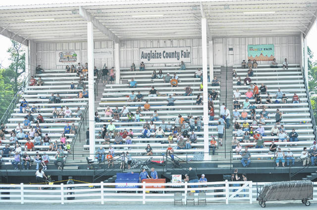 By 6 p.m. Thursday, dozens of people had already found seats in the Auglaize County Fair Grandstand, waiting for the demolition derby to begin at 7:30 p.m. People began entering the grandstand as early as 5 p.m. to watch the event. People like Carl Williams, of Lakeview, and his wife Peggy, were willing to wait two and a half hours to get the perfect seat and watch as the arena was prepared.