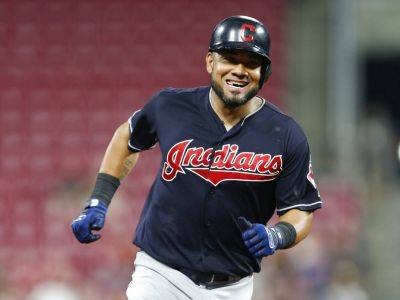 Cleveland Indians' Melky Cabrera reacts to hitting a two-run home run off Cincinnati Reds starting pitcher Cody Reed during the sixth inning of Wednesday's in Cincinnati. (AP Photo)
