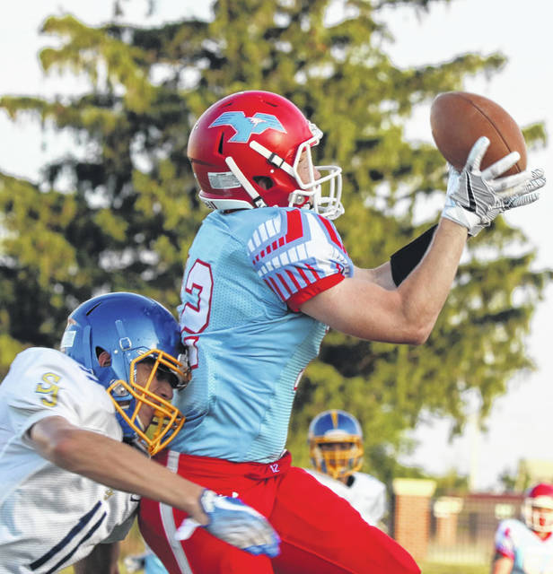 Brady Parrish of Delphos St. John's defends against Lima Central Catholic's Nathan Stolly during Friday night's game at Spartan Stadium. Stolly had three catches for 71 yards with one TD in the victory.