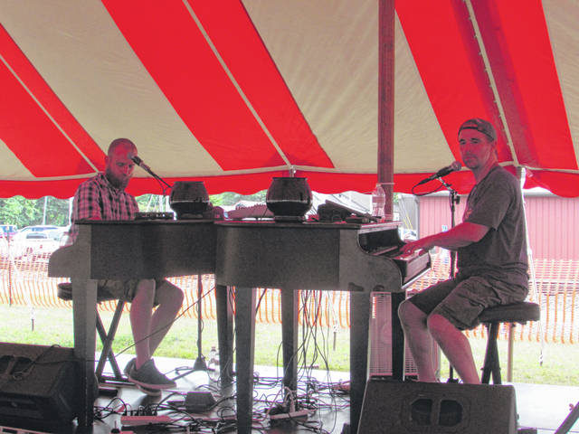 """Midwest Dueling Pianos was one of the featured bands playing last year at Little Nashville. Here they playing the Elton John Classic """"Rocket Man."""""""
