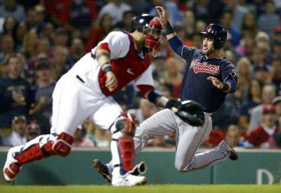 Cleveland's an Gomes, right, scores as the Red Sox's Sandy Leon waits for a throw on a single by Michael Brantley during the sixth inning of Tuesday night's game in Boston. (AP photo)