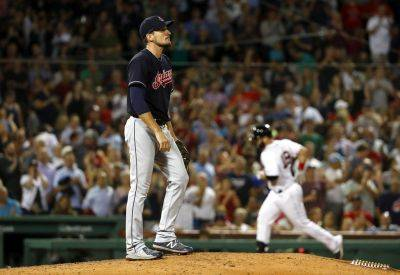 Cleveland Indians relief pitcher Dan Otero walks back up the mound as Boston Red Sox's Mitch Moreland rounds the bases after his two-run home run during the sixth inning of Wednesday night's game in Boston. (AP photo)