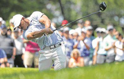 Brooks Koepka tees off on the fourth hole during Saturday's third round of the PGA Championship at Bellerive Country Club in St. Louis.