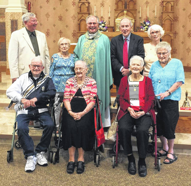 A 70th class reunion is quite the rarity. Members of the class of 1948 at St. Rose High School pose with Rev. David Ross (back row center) Saturday at St. Rose Catholic Church.