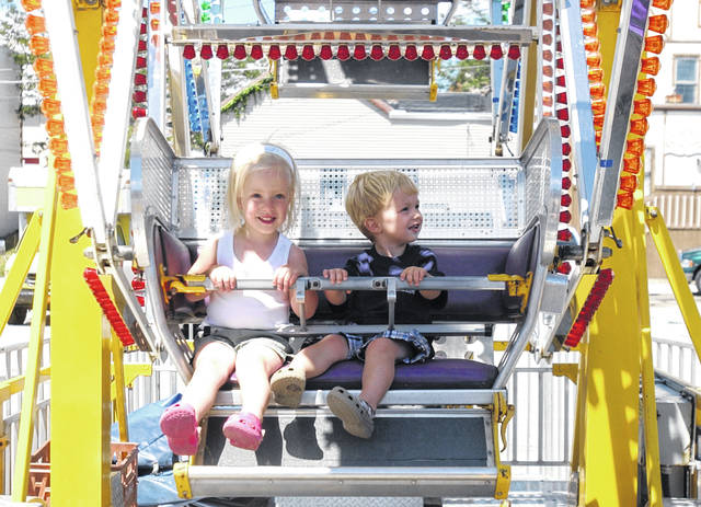 Children ride on the Ferris wheel at a previous St. Marys Summerfest.