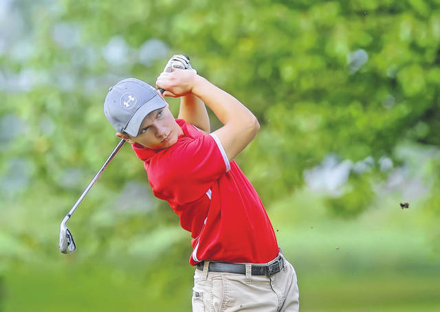 Columbus Grove's Jacob Oglesbee hits a tee shot on the 11th hole during Wednesday's tri match at Delphos Country Club. See more match photos at LimaScores.com.