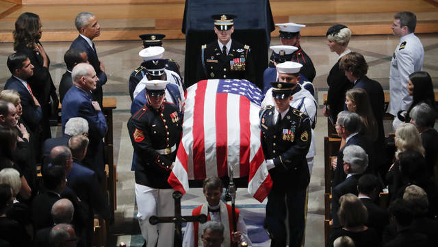 The family of Sen. John McCain R-Ariz. follows as his casket is carried during the recessional at the end of a memorial service at Washington National Cathedral in Washington Saturday Sept. 1 2018. Mc Cain died Aug. 25 from brain cancer at age 81. (A