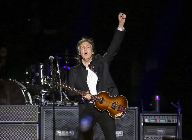 """FILE  - In this Monday, Sept. 11, 2017 file photo, singer/songwriter Paul McCartney performs on stage at the Prudential Center  in Newark, NJ. Former Beatle McCartney has told a British newspaper he believes he once saw God during a psychedelic trip. The 76-year-old music legend told The Sunday Times he was """"humbled"""" by the experience. The music legend is promoting a new album and a fall tour, it was reported on Sunday, Sept. 2, 2018. (Photo by Brent N. Clarke/Invision/AP, File)"""