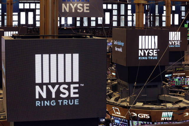 FILE- In this Aug. 21, 2018, file photo screens above trading posts on the floor of the New York Stock Exchange show the NSE logo. The U.S. stock market opens at 9:30 a.m. EDT on Tuesday, Sept. 4, 2018. (AP Photo/Richard Drew, File)