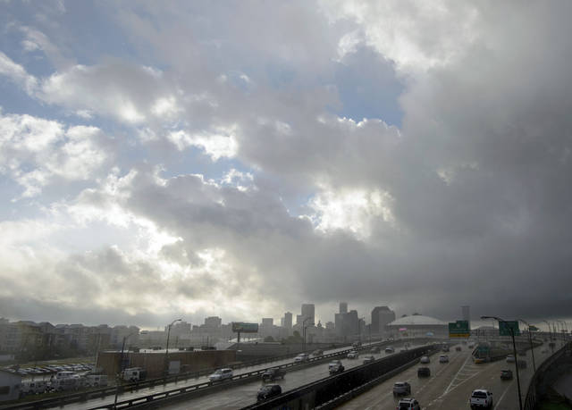 Sheets of rain and heavy clouds move into the city ahead of the landfall of Tropical Storm Gordon in New Orleans, La. Tuesday, Sept. 4, 2018. (Matthew Hinton /The Advocate via AP)