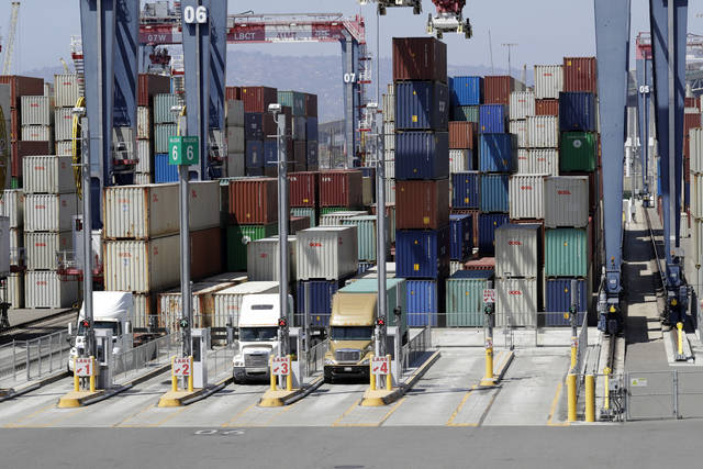 FILE- In this Aug. 22, 2018, file photo cargo is unload from trucks at the Port of Long Beach in Long Beach, Calif. On Wednesday, Aug. 5, the Commerce Department reports on the U.S. trade gap for July (AP Photo/Marcio Jose Sanchez, File)