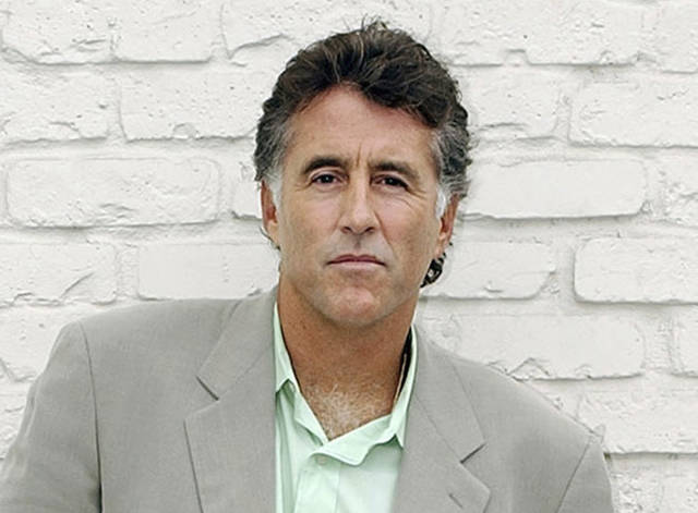"FILE - In this Sept. 16, 2005 file photo, Christopher Kennedy Lawford poses for a photograph in Encino, Calif., to promote his book, ""Symptoms of Withdrawal: A Memoir of Snapshots and Redemption."" Patrick Kennedy says Lawford died of a heart attack on Tuesday, Sept. 4, 2018, in Vancouver. He was 63. (AP Photo/Rene Macura, File)"