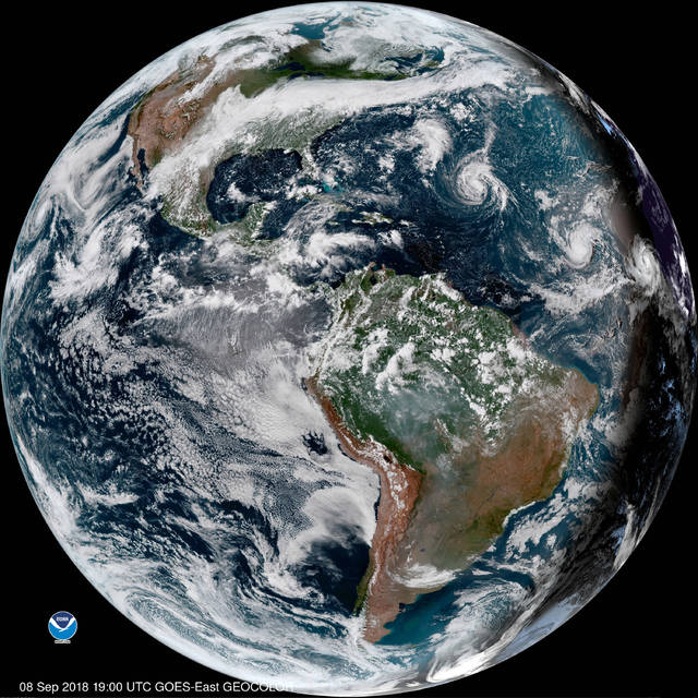 This enhanced satellite image made available by NOAA shows Tropical Storm Florence third from right in the Atlantic Ocean on Saturday Sept. 8 2018 at 3 p.m. EDT. At right off the coast of Africa is Tropical Storm Helene and second from right is Trop
