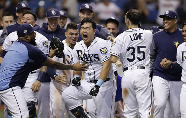 Tampa Bay Rays' Ji-Man Choi, of South Korea, center, celebrates his two-run walk-off home run off Cleveland Indians pitcher Brad Hand during the ninth inning of a baseball game Monday in St. Petersburg, Fla.