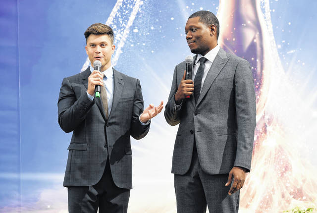 Colin Jost, left, and Michael Che, co-hosts for the 70th Emmy Awards, speak to the media before rolling out the gold carpet outside Microsoft Theatre on Thursday in Los Angeles. The awards will be held on Monday.