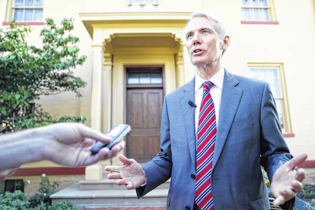 "Sen. Rob Portman, R-Ohio, is interviewed outside the William Howard Taft National Historic Site, Friday, Sept. 14, 2018, in Cincinnati. Portman, who's been a strong advocate for Supreme nominee Brett Kavanaugh, remains confident he will be confirmed after a ""way too partisan"" battle in Washington."