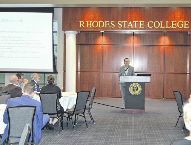 Bernard Swiecki, Center for Automotive Research senior project manager, discusses auto sales with a crowd during the Sixth annual Regional Auto Growth Summit Friday at Rhodes State College.