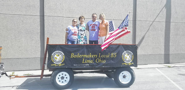 Karen Miller, Janet Garrett, Jack Miller and Betty Sutton stand in the offical Boilmakers Local 85 trailer outside of the Allen County Democratic Party headquarters, 562 W. Market St., Lima.
