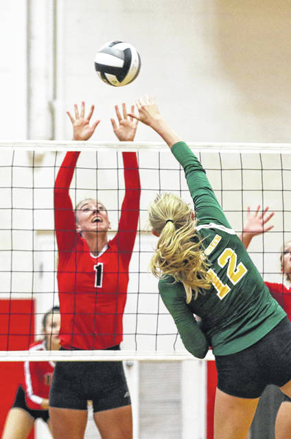 Delphos Jefferson's Ali McClurg challenges Ottoville's Taylor Beining during Thursday night's match in Delphos.
