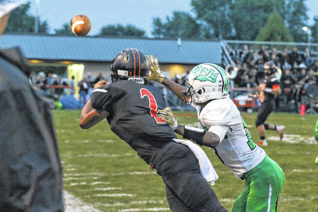 Elida's Keshawn Spivey dives for the throw from Evan Unruh while being defended by Celina's Jordan Song during Friday night's game at Elida. Spivey finished with eight catches for 154 yards.