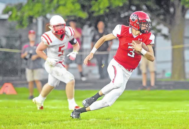 Kenton's Landon Rush gets in the open field during Friday night's game Wapakoneta at Robinson Field in Kenton. Rush had five catches for 128 yards, including a a 31-yard TD reception, in the Wildcats' win.