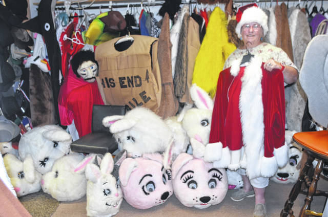 Barb Lochnerd, owner of Once Upon A Fantasy at 216 S Greenlawn Ave., Elida, shows off her Santa Claus outfit.