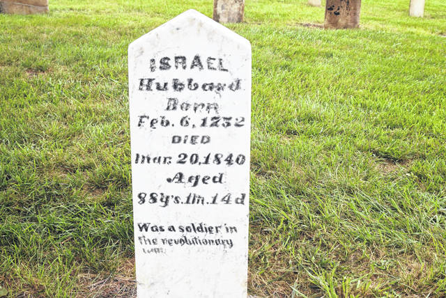 The restored grave marker of Israel Hubbard, Jr. sits in Malahan Cemetery in Riley Township, Putnam County.