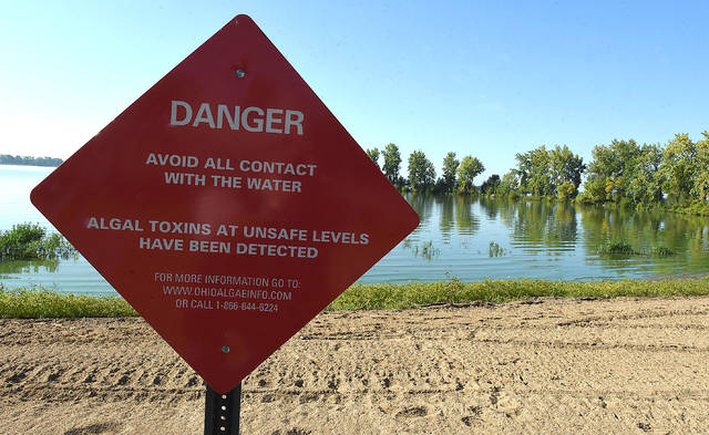 Warning signs along Grand Lake St. Mary's State Park beaches.