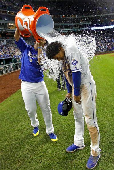 The Royals' Adalberto Mondesi is doused by Salvador Perez after the team's Saturday night game against Cleveland in Kansas City, Mo. The Royals won 9-4. (AP photo)
