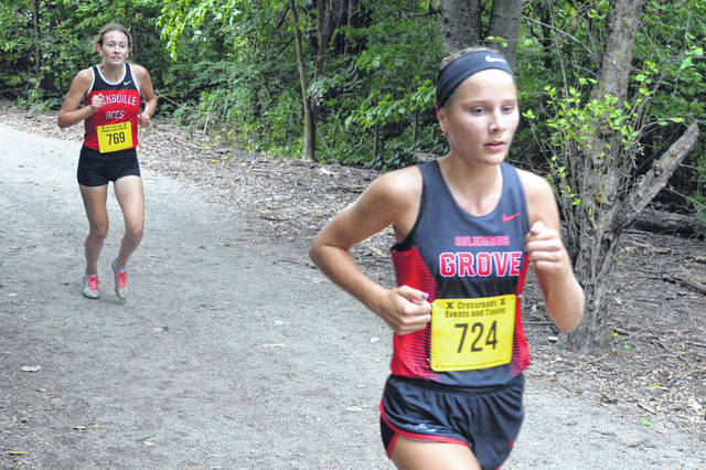 Columbus Grove's Alyssa Ellerbrock leads Hicksville's Tiffany Chippetta during Saturday's Columbus Grove Invitational.
