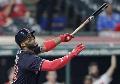 The Indians' Yandy Diaz hits a one-run triple in the seventh inning of Tuesday night's game against Kansas in Cleveland. (AP photo)