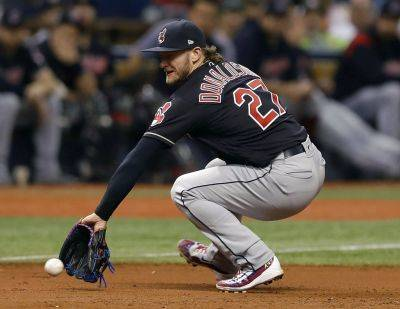 Cleveland third baseman Josh Donaldson fields a ground ball by Tampa Bay Rays' C.J. Cron during Tuesday night's game in St. Petersburg, Fla. (AP photo)