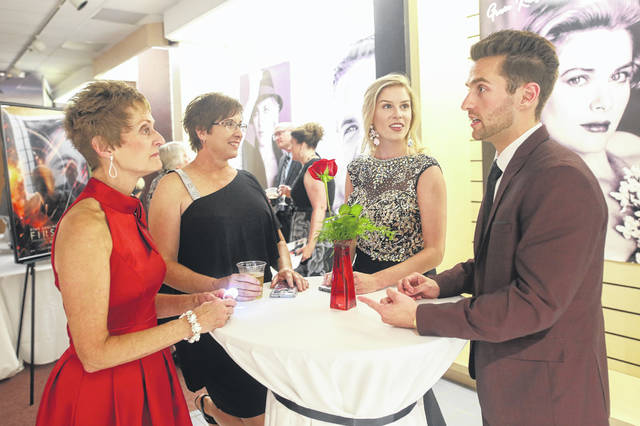Jan Hawk (left), Lisa Wende, Veronica Wende and Mark Hawk enjoy a drink together at the Journey to the Red Carpet Gala for Lima Memorial held at the Lima Mall on Thursday evening.